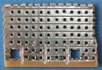 This is the bottom of the veroboard. Mounting holes are already drilled and tracks are cut in the middle under the light barrier. Tracks are also cut towards the mounting holes for preventing shorts because of the mounting screws.
