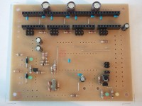 """Q3 is a LP2950 voltage regulator, comes mounted on brownish cardboard and reads some gibberish on the package. Q4 has the same package, is an 2N7000 MOSFET, comes mounted on silvery cardboard and actually reads """"2N7000"""" on it. Insertion direction matters for both, note the flat on the housing."""