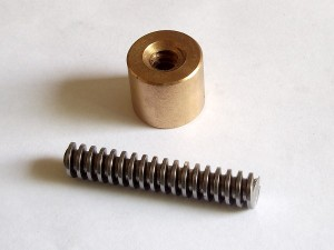 A typical brass nut and a short piece of matching rod, both Tr10x3.